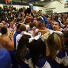 Danvers fans and cheerleaders mob the basketball team following a 70-67 OT victory for the Falcons over Wayland, sending Danvers to the D3 North Final on Saturday. David Le/Staff Photo