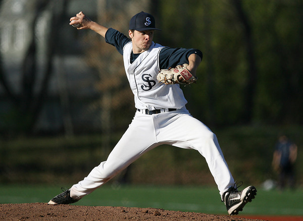 St. John's Prep senior Rob DiFranco fires a strike against Peabody on Tuesday afternoon. David Le/Staff Photo