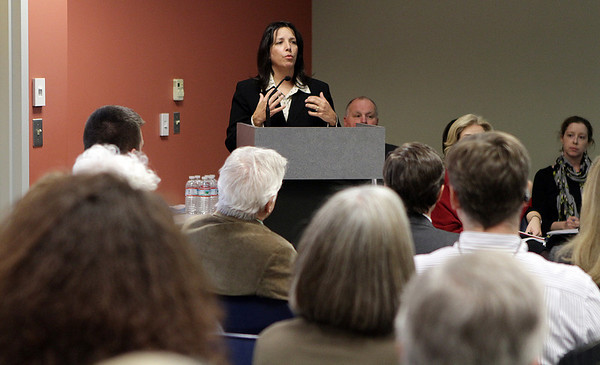 Mayor Kim Driscoll addresses a room full of people at the Enterprise Center regarding issues on how to quickly improve Salem schools. David Le/Salem News
