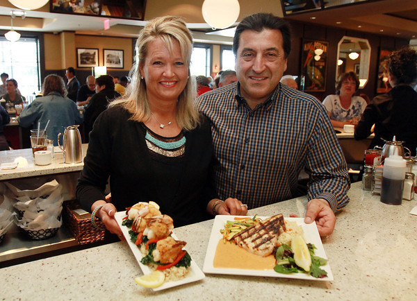 John and Lisa Drivas, owners of Red's Kitchen and Tavern, display a few of the daily specials that they offer. The couple also own Red's Sandwich Shop in downtown Salem, and have expanded to open this new restaurant located at 131 Newbury St. in Peabody, off of Route 1 North. David Le/Staff Photo