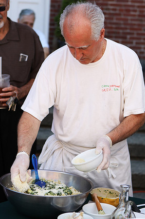 Salem: Chef Giovanni Grazziani spreads some parmesan cheese on his fresh made pesto at a cooking demonstration held at the Salem Farmers Market in Derby Square on Thursday afternoon. Photo by David Le/Salem News