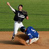 St. John's Prep second baseman Tom Buonopane, left, manages to get a throw away as Danvers runner Nick Valles, right, slides hard into the base on Saturday evening at Twi-Field. David Le/Staff Photo