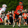 Beverly's Brendan Flaherty, right, looks to get past Masco defender Jake Gillespie, left, during the North Shore Cup. Flaherty scored two goals and added an assist, but the Chieftans defeated the Panthers 15-9 on Wednesday afternoon. David Le/Staff Photo