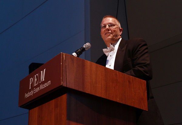 Rinus Oosthoek, Executive Director of the Salem Chamber of Commerce, addresses a large crowd in the atrium of the Peabody Essex Museum for the 100th Anniversary of the Chamber. David Le/Staff Photo