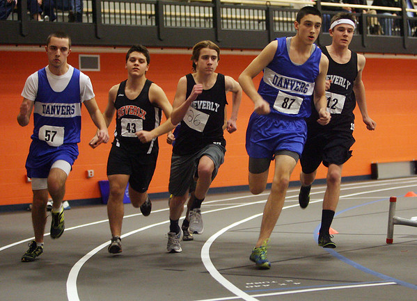 Beverly: Danvers junior Drew Piazza (87) second from right, paced all other runners in the 1000m race on Thursday. David Le/Salem News