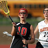 Marblehead attacker Kiley Fischer, left, keeps her eyes on the ball, while being defended by Beverly's Katie Pietrini, right, on Wednesday afternoon. The Magicians defeated the Panthers 16-6. David Le/Staff Photo