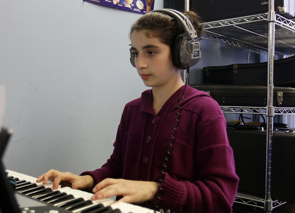 Marblehead Community Charter Public School 6th grader Stephanie Arustamyan practices a piece of music on a rainy Wednesday afternoon. David Le/Salem News