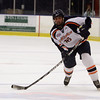 Salem State defenseman Tom Mahoney takes a slap shot on net on Thursday night. David Le/Salem News