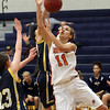 Salem State's Rachael Carter (11) loses control of the ball after she is fouled by two University of Southern Maine players on Tuesday evening. David Le/Salem News