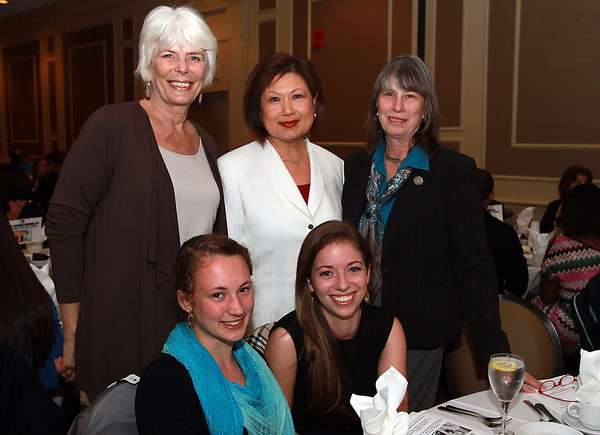 Waring School seniors Caitlin Towers, front left, and Rebecca Patey, front right, were accompanied by teachers from back left, Paige Gentleman, Dorothy Wang, and Allegra Smick, to the 44th Annual Honor Scholars Recognition Dinner at the CoCo Key Hotel on Tuesday evening. David Le/Staff Photo