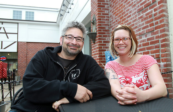 Steve Feldmann, left, owner of Gulu-Gulu Cafe, sits with, Allison Croughwell, right, future manager of Flying Saucer, a pizza joint that Feldmann plans to open this summer in the space where Upper Crust Pizza used to be, adjacent to Gulu-Gulu. David Le/Staff Photo
