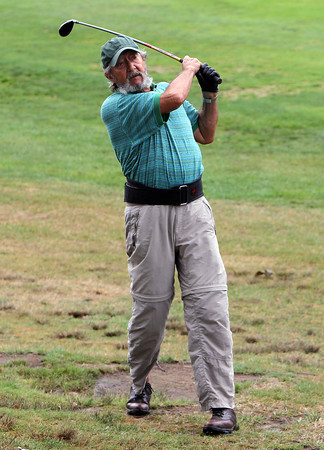 Neal Keefe-Feldman hits a shot from the fairway while playing in the senior division of the Beverly Golf and Tennis Club Championship on Saturday. David Le/Staff Photo