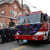 Peabody: Peabody Engine 5, carrying the casket of deceased Peabody firefighter Jim Rice, slowly rolls past the Peabody Fire Department on Lowell St. for the last time carrying Rice. David Le/Salem News