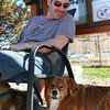 Shawn Brady, left, of Salem, sits with his dog Raffael, in the shade at the Salem Dog Park on Wednesday afternoon. David Le/Staff Photo