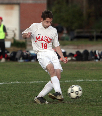Masco's Justin Clark calmly puts away the winning penalty kick, propelling Masco into the semi-finals. David Le/Salem News