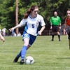 Danvers Girls U-14 Tornados player Kristen McCarthy, center, drives to the net against Woburn during the Danvers Invitational Tournament on Monday morning. David Le/Staff Photo