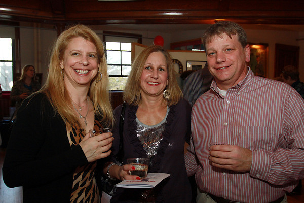 From left, Juliana Lloyd, Arlyne Campbell, and Jerry Tucker, all of Marblehead at the Annual Art Auction held at Abbott Hall on Saturday afternoon. David Le/Staff Photo