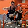 Peabody's Zack Grube flies over a hurdle to win the 50m high hurdle race against Beverly on Thursday afternoon. David Le/Salem News