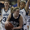 Swampscott's Caroline Murphy (20) center, looks to pass while being pressured by Peabody's Caroly Scacchi (34) left, and Olivia Summit (41) right. David Le/Salem News