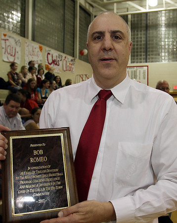 Masco head coach Bob Romeo was honored before the basketball game on Senior Night, for his 10 years of service to the Girls Basketball team. David Le/Salem News