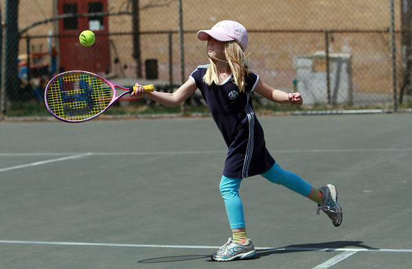 Meghan Deiana, 8, of Marblehead, plays tennis with her sisters Emma, 11, and Katie, 6 (not pictured) on a warm Friday afternoon at Seaside Park. David Le/Staff Photo