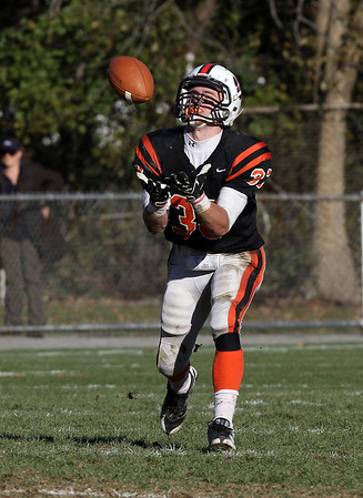 Beverly runningback Brendan Flaherty (33) fields a punt and turns upfield against Swampscott on Saturday afternoon. David Le/Salem News