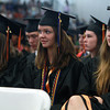 Beverly High School graduates from left, Meagan Lewis, Hayley Lewis, and Renata Lemos, listen to speeches during their graduation on Sunday afternoon. David Le/Staff Photo