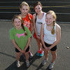 The Hamilton-Wenham 4x800 relay team from left, sophomore Emily Horgan, junior Meg Blatchford, senior Emily Senning, and freshman Emily Weigand, will be competing in the New Balance Nationals meet in New York City on Saturday night. David Le/Staff Photo