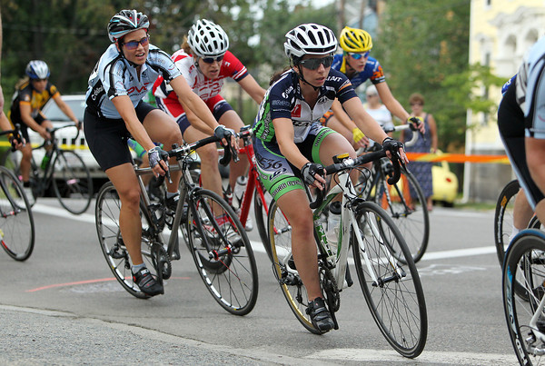 Rider's in the Women's Elite race in the Witches' Cup make the turn onto S. Washington Square on Wednesday evening. David Le/Staff Photo