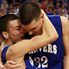 Danvers seniors Jon Amico, left, and George Merry, celebrate on the court at the TD Garden following a 68-45 win over Wareham on Monday afternoon in the State Semi-Final. David Le/Staff Photo