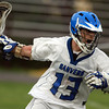 Danvers attacker Steven Christopher shields the ball against Beverly on Thursday afternoon. David Le/Staff Photo
