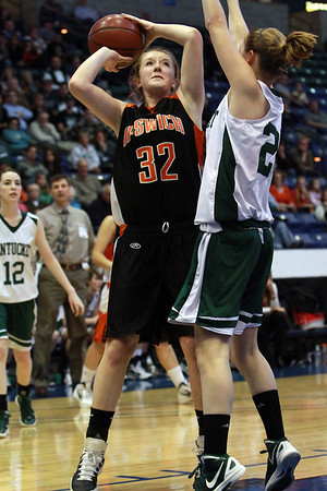 Ipswich junior Julia Davis (32) left, tries to shoot over a Pentucket defender on Saturday morning in the D3 North Girls Final at the Tsongas Center in Lowell. David Le/Staff Photo