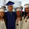 Swampscott High School graduates from left, Kelly Birchmore, DJ Bray, Jesse DePaolo, and Lara Dandreo, pose for a photo before grdauation on Sunday. David Le/Staff Photo