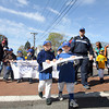 Damien Biersteaker, left, and Nicholas Spanos, right, of the C-6 Royals of Danvers American Little League leads their team through Danvers Square during the Opening Day Parade on Saturday. David Le/Staff Photo