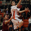 Beverly's Chris Keaton goes in for a layup against Lynn English on Friday night/ David Le/Salem News