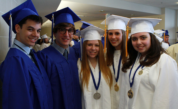 Swampscott High School graduates from left, Justin Hynes, Tobin Bartolo, Devyn Jaffee, Anna Booras, and Paulina Perlin, pose for a photo before graduation on Sunday. David Le/Staff Photo