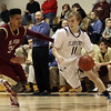 St. John's Prep senior Freddy Shove (11) drives past a BC High defender on Friday night. David Le/Salem News
