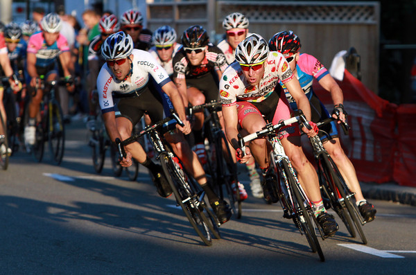 Racers in the Men's Elite Division of the Beverly Gran Prix lean hard into a turn onto Cabot Street as they come down the home stretch on Wednesday evening. David Le/Staff Photo