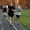Danvers High School Tyler MacInnis runs a track workout on Thursday afteroon. David Le/Salem News