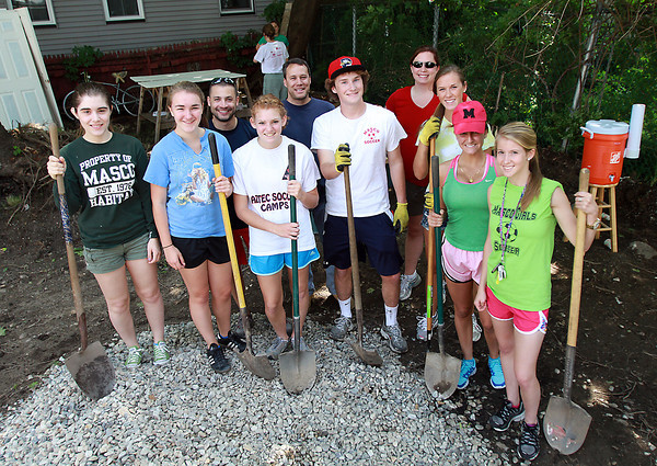 Front row from left: Masco junior Emily Schultz, sophomore Olivia Binette, sophomore Sarah Katz, junior Derek Grammer, sophomore Fiona Greenaway, junior Vanessa Salvo, and junior Katherine Dobson. Back row from left, Masco Habitat Advisor John Lebel, Jamie Marshall, and Masco Habitat Advisor Karen Wood. David Le/Staff Photo