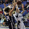Peabody's Katie Brunelle (14) goes in for a layup against Swampscott's Ara Talkov (24). David Le/Salem News