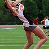 Beverly freshman Kendel Davy extends over the high jump bar on Tuesday afternoon. David Le/Staff Photo