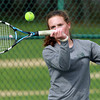 Hamilton-Wenham 2nd singles player Caroline Gribbell keeps her eyes on the ball as she makes contact while playing against Danvers on Friday afternoon. David Le/Staff Photo