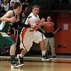 Beverly: Beverly junior Dom Abate (11) right, drives past Lynn Classical defender Eraldo Custodio (21) left on Tuesday night.  David Le/Salem News