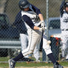 Hamilton-Wenham's Austen Michel lines a base hit to left field against North Reading on Tuesday afternoon. David Le/Staff Photo