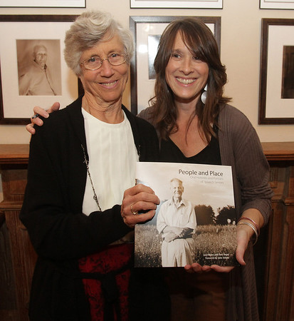 "Ipswich residents Lucy Myers, left, and Terri Unger, right, collaborated to make a book titled ""People & Places: Oral Histories and Portraits of Ipswich Seniors,"" of first-person narratives with lifelong Ipswich residents as their subject. David Le/Salem News"