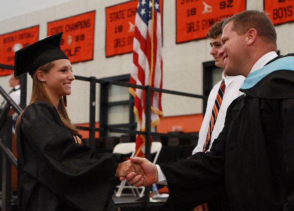 Beverly High School graduate Mandy Cecchini shakes hands with Beverly High School Principal Sean Gallagher, on Sunday afternoon. David Le/Staff Photo
