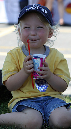 Danvers: Riley Glaser, age 3, of Wakefield enjoys a slush on a hot summer day. Photo by David Le/Salem News
