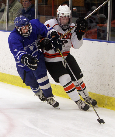 Salem: Beverly captain Andrew Irving (7) right, and Danvers sophomore Tyler Dustin battle for position as they go after a loose puck.  David Le/Salem News