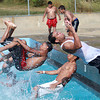 A group of Salem teens jump into the pool at Forest River Park in Salem to cool off on a scorching July afternoon. David Le/Staff Photo